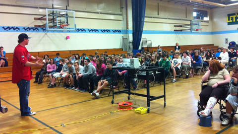 Sea Dogs catcher Matt Spring talks to students at the Loranger Middle School about the dangers of inhalants.
