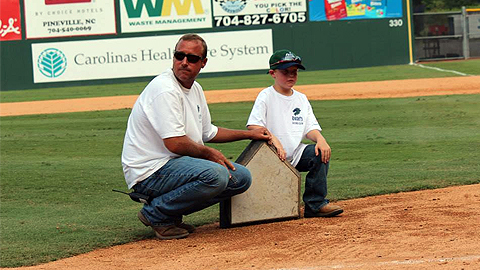 Groundskeeper Eddie Busque, along with his son Hunter, removed home plate on September 2.