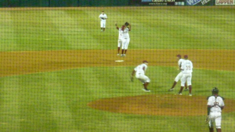 The Wisconsin Timber Rattlers celebrate their second straight win after a 7-4 victory over the West Michigan Whitecaps on Thursday night.