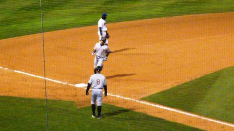 Jose Sermo heads for third base after his three-run home run on Monday night in Cedar Rapids.