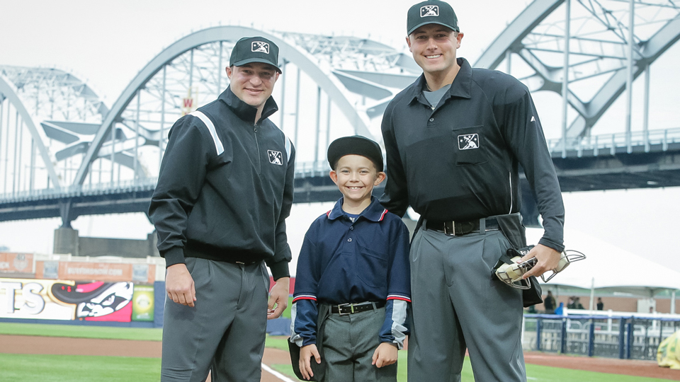 13738069e5c Grant Dahlstrom was recognized as true blue by umpires Jake Bruner (left)  and Trevor Dannegger. (Rich Guill Quad Cities River Bandits)