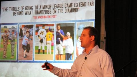 Michael Hand, CMO of Minor League Baseball, presents at the Seminar.
