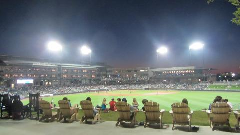 Fans take in a Barons game in cozy Adirondack chairs from the outfield.