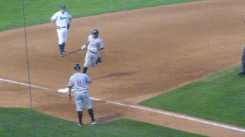Tyrone Taylor heads for third after his seventh inning grand slam puts Wisconsin up 8-6 over the Cedar Rapids Kernels on July 5, 2013.