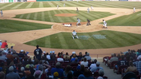 Mitch Haniger slides home with the final run of Wisconsin's five-run seventh inning on Saturday afternoon. The Timber Rattlers beat West Michigan 7-6.