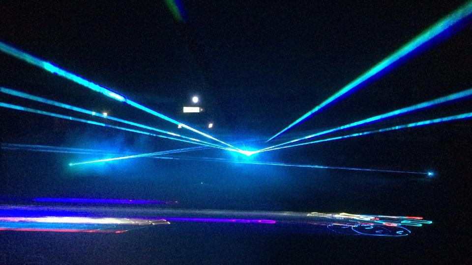 a brilliant multi colored laser light show dazzled families during the holidays during the intimidators first annual holiday laser light experience in