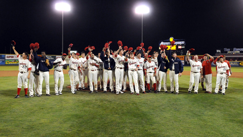 Spokane Indians players tip their hats to the Avista Stadium crowd after their final home game.