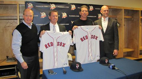 PawSox President Mike Tamburro, left, and Boston Red Sox Director of Player Development Ben Crockett, right, introduce new PawSox manager Kevin Boles, second from left, and coach Bruce Crabbe during the annual PawSox Hot Stove Media Day at McCoy Stadium.