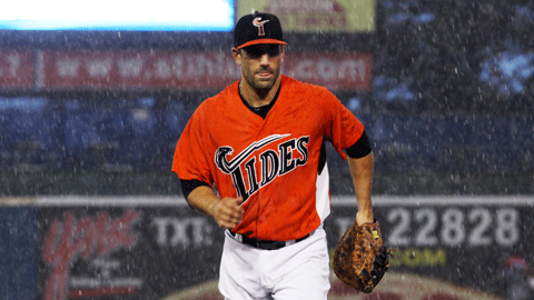 Russ Canzler leaves the field after rain halted play Wednesday night
