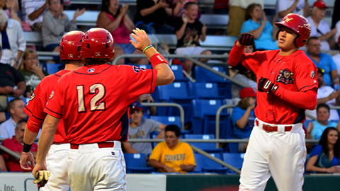 Dylan Cozens crosses the plate after his 7th home run of the year.