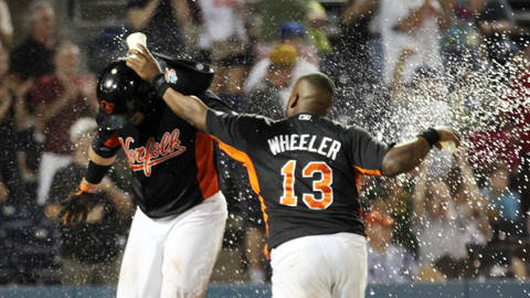 Zelous Wheeler douses Luis Exposito with water after Exposito scored the winning run Saturday night at Harbor Park.