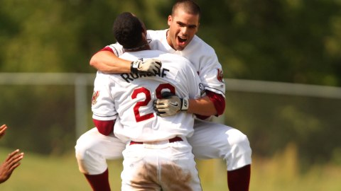 Victor Roache gives Mike Garza a bearhug after Garza's game-winning RBI double in the bottom of the ninth on Tuesday afternoon.