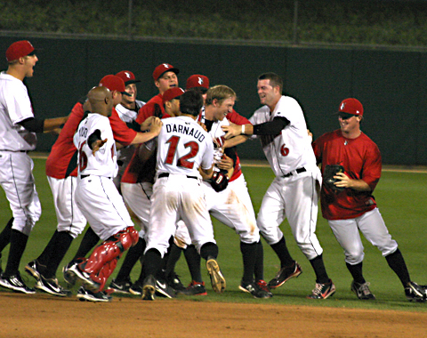 The Indians mob Jared Goedert after his walk-off double in the bottom of the 9th.