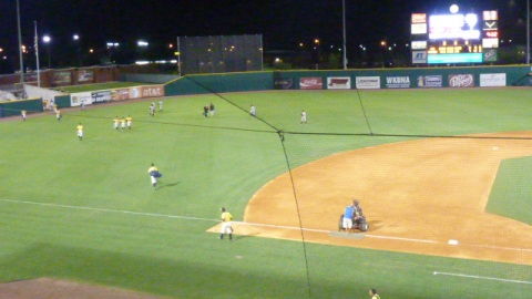 The teams head back to their respective clubhouses after Bowling Green's 7-0 win over the Timber Rattlers on July 19, 2013