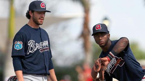 Dansby Swanson (l) and Ozzie Albies worked together in March but are moving through the system apart.