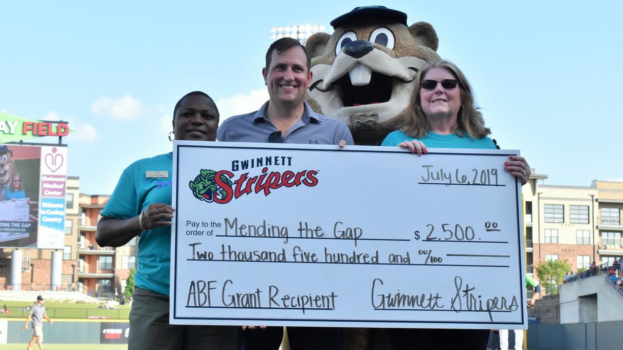 Bear Stripers gwinnett stripers award monthly grant to mending the gap