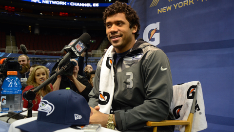 Russell Wilson handles questions at Super Bowl Media Day.