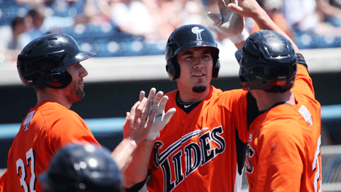 Travis Ishikawa is congratulated after the first of his two home runs Thursday.
