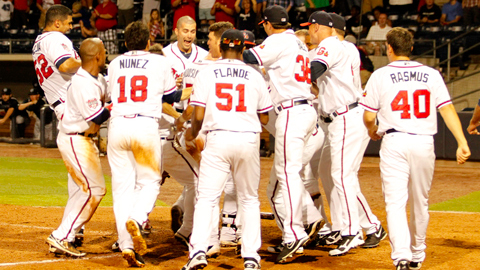Joey Terdoslavich is greeted at home plate after his walk-off homer.