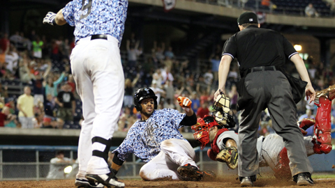 Chris Dickerson slides home safely in a walk-off win, August 10 vs. Rochester.