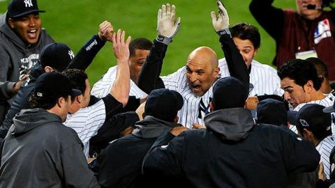 Raul Ibanez is mobbed by his teammates after his game-winning home run against Baltimore in Game Three of the 2012 American League Division Series.