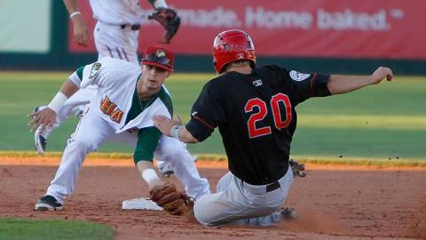 Danny Lockhart tags out Brenden Kalfus trying to steal second base in the fourth inning of the Hawks 5-0 victory over Vancouver