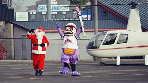 Santa arrives via helicopter to greet hundreds of Volcanoes fans and families Saturday November 30th at Volcanoes Stadium.