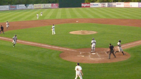 Adam Giacalone heads for the plate as Alfredo Rodriguez tries for third in the third inning of Friday's game at Community Field. The Timber Rattlers would win the game 8-4.