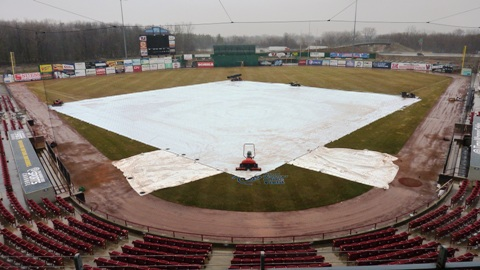 The tarp stays on the field for the third day in a row.