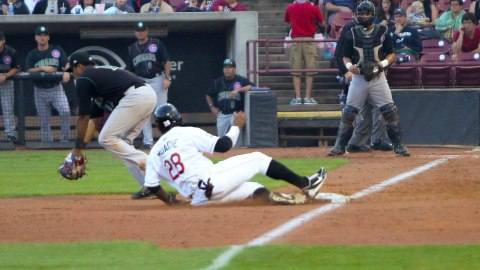 Victor Roache slides into third base after a fourth inning single by Mike Garza on Wednesday, July 3 against the Kane County Cougars.