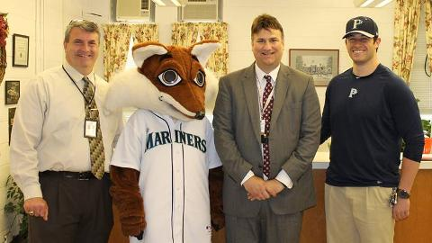 Ryan Kiel (right) with Pulaski school officials Greg Brown, Thomas Brewster and mascot Slyder.