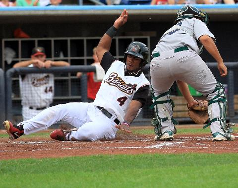 Teoscar Hernandez slides into home for the first run Saturday.