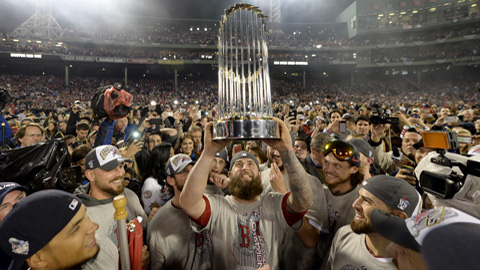 BOSTON, MA - OCTOBER 30: Mike Napoli #12 of the Boston Red Sox lifts the Commissioner's Trophy after winning Game 6 to clinch the 2013 World Series against the St. Louis Cardinals at Fenway Park on Wednesday, October 30, 2013 in Boston, Massachusetts. (Photo by Rob Tringali/MLB Photos via Getty Images) *** Local Caption *** Mike Napoli