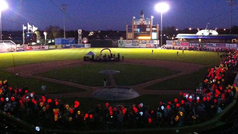 Participants held illuminated balloons during the 2012 Light the Night Walk at Whitaker Bank Ballpark.