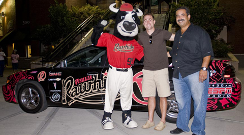 Dave Bellis won a free Pontiac Grand Prix Sedan on Saturday night at Rawhide Ballpark thanks to Ed Dena's Auto Center.
