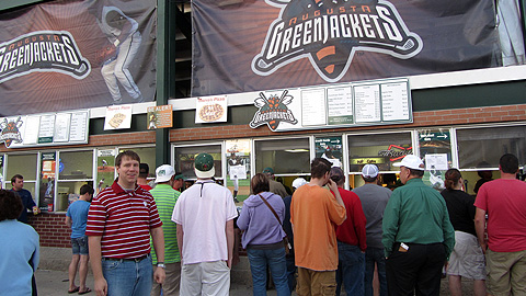 Designated eater Chad Walters (left) waits on line for free food in Augusta.