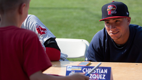 Christian Vazquez signs autographs before Tuesday's Home Run Derby.