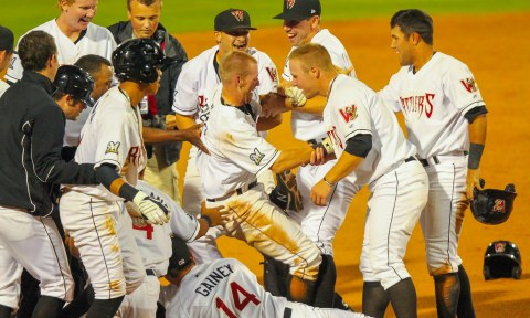 Michael Reed is pulled out of a pile of Timber Rattlers after the Timber Rattlers walkoff victory over the Beloit Snappers on August 5, 2013