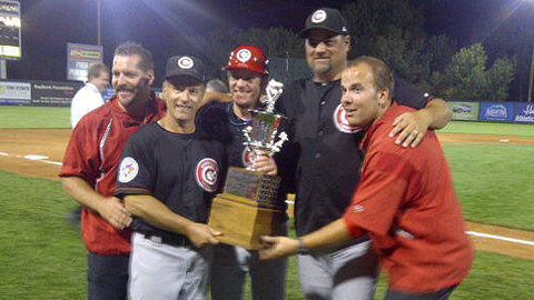 Manager Clayton McCullough and his coaches hoist the Freitas Trophy.