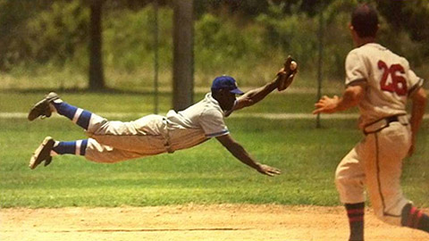 "Balcom dives for a ball while depicting Jackie Robinson in the film ""42."""
