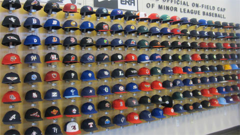 Minor League Baseball hats on display in St. Petersburg.
