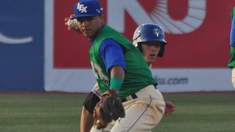 Lexington Legends' second baseman Yowill Espinal throws to first to complete a double play in the third inning of Tuesday night's game at Whitaker Bank Ballpark. The Asheville Tourists defeated the Legends 4-3 in 13 innings.