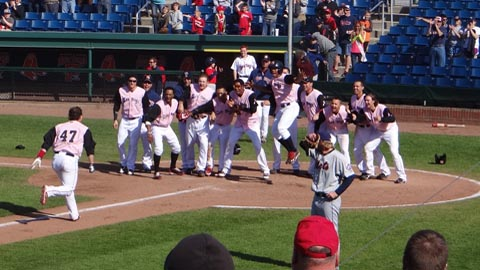 Matt Spring is greeted at home plate after his third career grand slam.