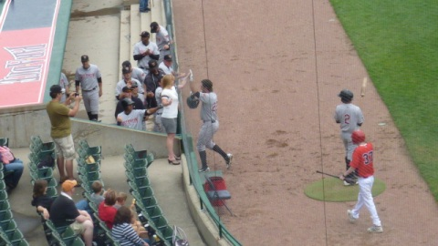 Parker Berberet is greeted at the Wisconsin dugout after his fifth inning home run on Memorial Day.