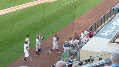 Victor Roache is greeted by his teammates at the dugout after his second inning grand slam in Dayton. Roache hit a pair of homers and drove in seven runs on July 22, 2013.