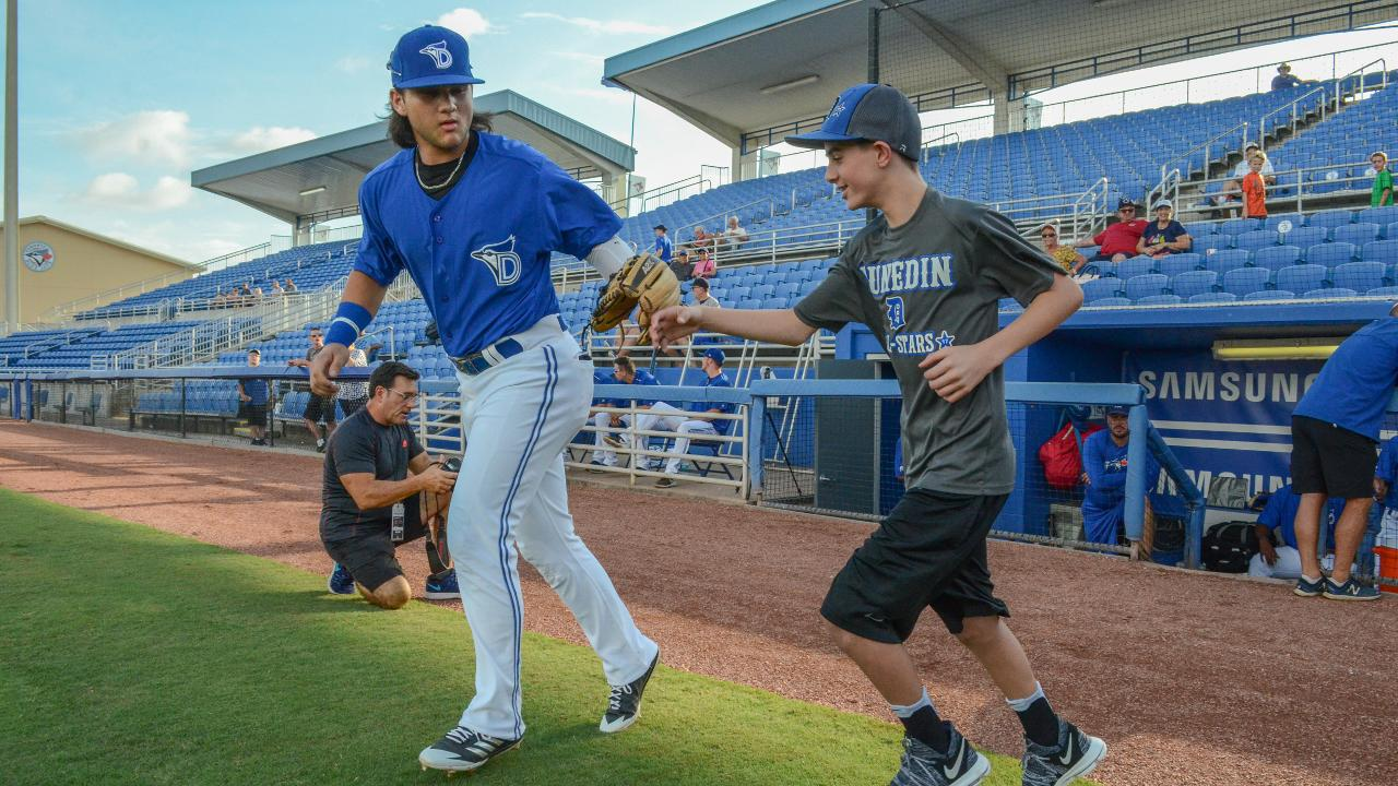 d51fee49879 Dunedin shortstop Bo Bichette high-fives a local little leaguer on his way  to the field before a recent game. (Allasyn Lieneck)