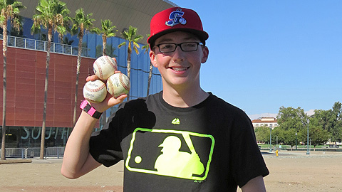 Nick Badders, 15, has become skilled at snagging baseballs at California League games.
