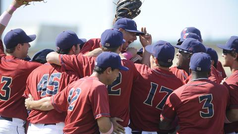 Luis Cruz and his teammates celebrate near the mound after completing the no-hitter.