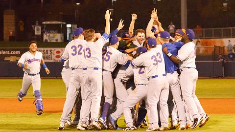 The Midland RockHounds celebrate after winning their fourth straight Texas League championship.