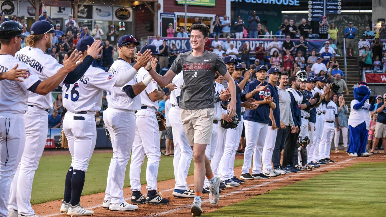 1c3ddffde04 Caleb Castle is greeted by Blue Wahoos players as he begins his Home Run  For Life honor Saturday night. (Daniel Venn)